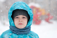 Portrait of a boy during a snowstorm Royalty Free Stock Images