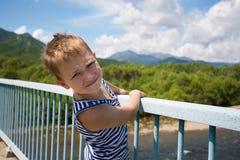 Portrait boy standing on the bridge Royalty Free Stock Photos