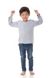 Portrait of boy standing in cheer up mood. Stock Photography