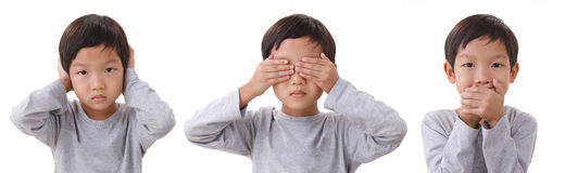 Portrait of boy standing closing the eyes mouth and ears. Isolat Stock Photography
