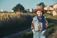 Portrait of a boy in a straw hat , country style. Portrait of a boy in a straw hat Royalty Free Stock Photography
