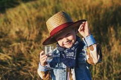 Portrait of a boy in a straw hat , country style. Portrait of a boy in a straw hat Stock Photos