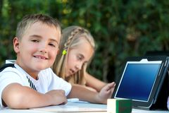Young boy showing tablet with copy space. Stock Photo