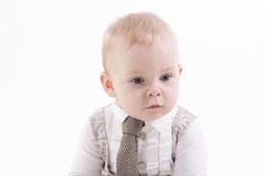 Portrait of a boy in a suit and tie. Portrait of a serious baby-boy in a suit and tie on a white background Stock Photo