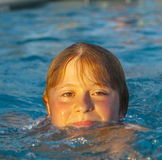 Portrait of a Boy swimming in the pool Stock Image