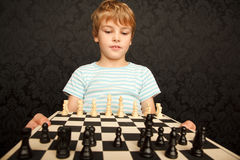 Portrait of boy in T-shirt with chessboard Stock Photography
