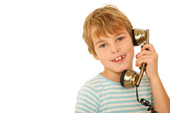 Portrait of boy in T-shirt talking to retro phone Stock Photo