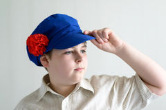 Portrait of boy teenager in Russian national cap with cloves Royalty Free Stock Photos