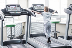 Portrait of a boy on the treadmill in the gym Royalty Free Stock Photos