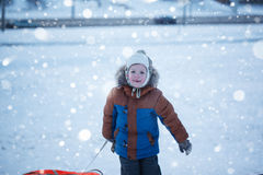 Portrait boy with tubing in the snow, wintertime, happiness concept. Royalty Free Stock Images
