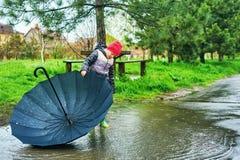 Portrait of a boy with an umbrella on a spring walk stock photos