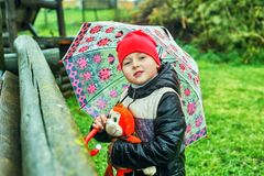 Portrait of a boy with an umbrella on a spring walk stock photo