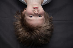 Portrait of a boy upside down Royalty Free Stock Images