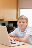 Portrait of a boy using a notebook Stock Photography
