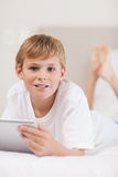 Portrait of a boy using a tablet computer Stock Photo