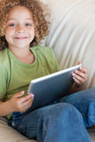 Portrait of a boy using a tablet computer Royalty Free Stock Photo