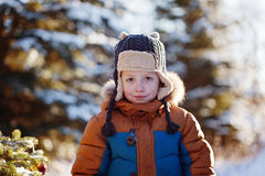 Portrait of a boy walking in the winter nature. Playing with snow. Concept happy childhood Stock Image