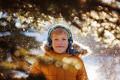 Portrait of a boy walking in the winter nature. Playing with snow. Concept happy childhood Royalty Free Stock Image