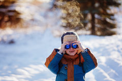 Portrait of a boy walking in the winter nature. Playing with snow. Concept happy childhood Stock Photo