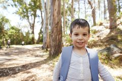 Portrait Of Boy Wearing Backpack On Countryside Walk Stock Images