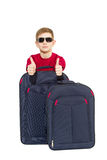 Portrait of boy wearing sunglasses showing thumbs up with travel Stock Images