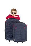 Portrait of a boy wearing sunglasses sitting with travel bags Royalty Free Stock Images