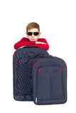 Portrait of boy wearing sunglasses with travel bags Royalty Free Stock Photo