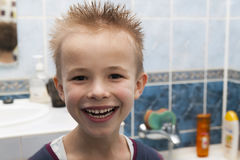 Portrait of a boy with wet hair after taking a shower of bath. F. Unny boy with crazy hairstyle Stock Photos
