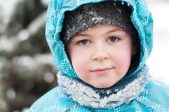 Portrait of a boy with wet snow from the face Royalty Free Stock Images
