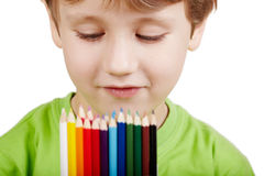 Portrait of boy who examines colour pencils Stock Images