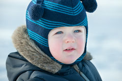 Portrait of a boy in winter clothes Stock Images