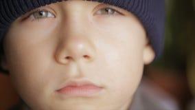 Portrait of a boy in winter hat. Full hd video stock footage
