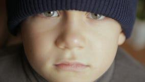 Portrait of a boy in winter hat. Full hd video stock video footage