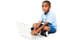 Portrait of boy working on laptop Stock Image