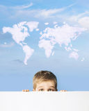 Portrait of a boy with world map above head Royalty Free Stock Photography
