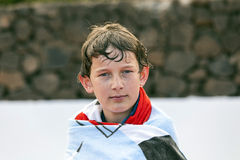 Portrait of a boy wrapped in a towel Stock Image