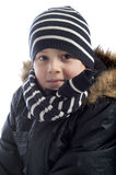Portrait of boy wrapped in winterclothes Royalty Free Stock Image
