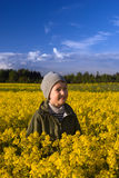 Portrait of a boy on a yellow field of flowers Royalty Free Stock Photo
