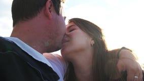 Portrait boyfriend and girlfriend when they kiss closeup background blue sky 4K. Portrait boyfriend and girlfriend when they kiss on background blue sky. Couple stock video footage
