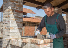 Portrait of bricklayer. Portrait mason who builds the outer wall of the building Stock Image