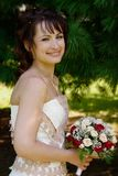 Portrait of bride. Bride  at a romantic garden waiting for her groom Stock Photos