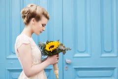 Portrait of a bride. Portrait of a beautiful bride in a wedding dress, holding a sunflower wedding bouquet stock photos