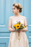 Portrait of a bride. Portrait of a beautiful bride in a wedding dress, holding a sunflower wedding bouquet Stock Images