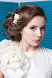 Portrait of the bride with big beautiful eyes on blue background Stock Photo