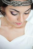Portrait of the bride with big beautiful eyes on white backgroun Stock Image
