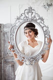 Portrait of the bride with big beautiful eyes on white backgroun Royalty Free Stock Photo