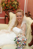 Portrait of bride with bouquet in hands indoors Royalty Free Stock Photo