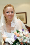Portrait of bride with bouquet in hands indoors Stock Photo