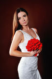 Portrait of the bride with a bouquet of red Stock Photo