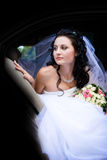 Portrait of the bride in the car Royalty Free Stock Images